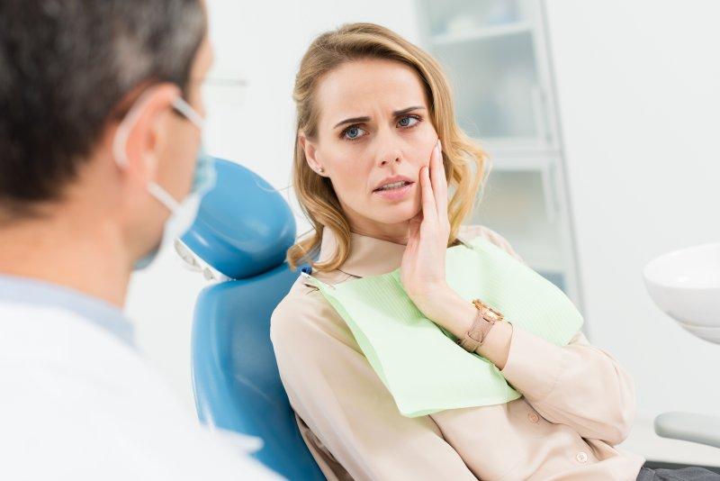 Female patient concerned at dentist