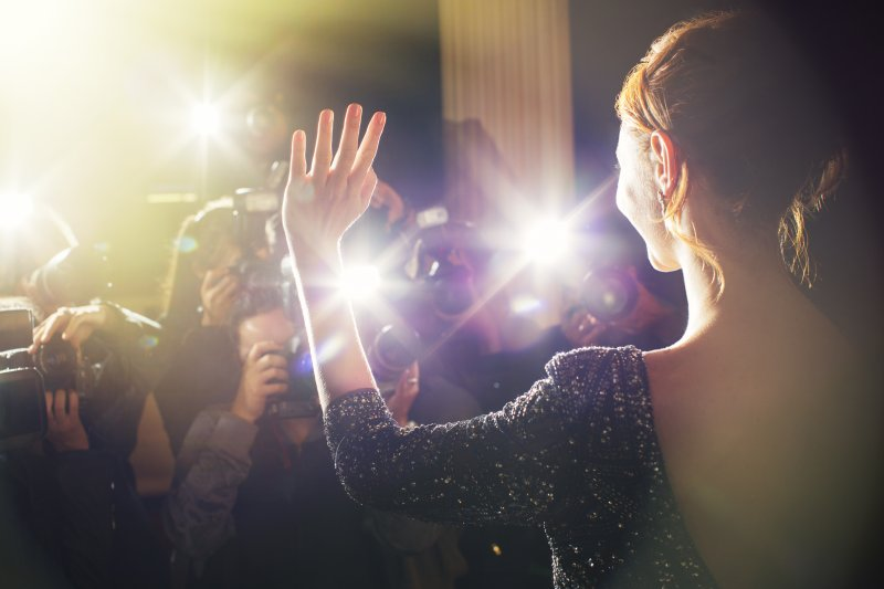 Celebrity smiling at red carpet event