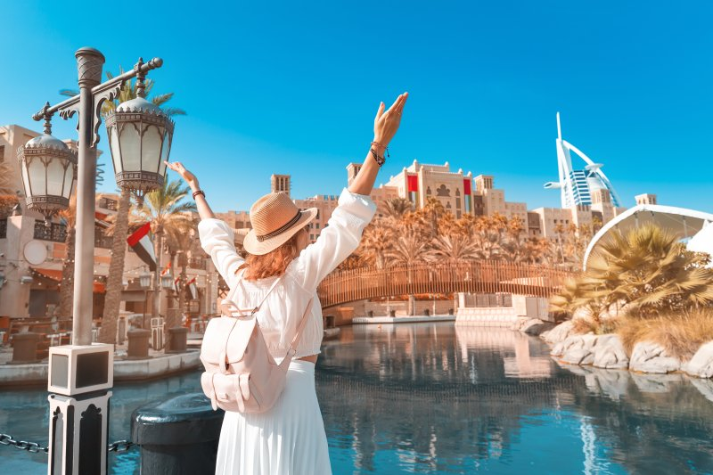 Excited woman sightseeing on vacation